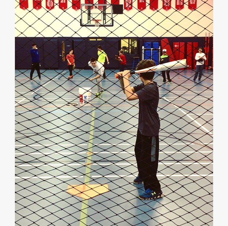 Children hitting baseball home runs at our Toronto sports programs